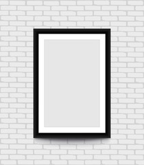 Blank picture frame for photographs on the brick wall.