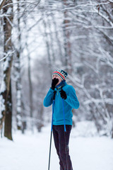 Photo of yawning skier athlete in forest