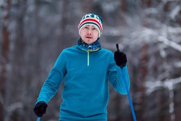 Portrait of male skier on blurred background