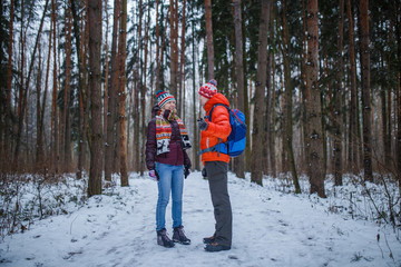 Image of sports man and woman standing in winter forest