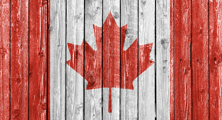 National flag of Canada on old weathered white wood background