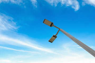 led street lamps with solar energy power on blue sky background