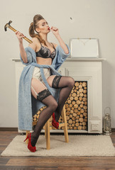 Pin-Up Girl and the hammer.