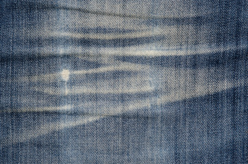 Texture of blue denim fabric.