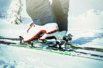 Detailed view of the ski bindings, Detailed view touring winter boots, is in motion.