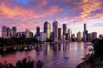 View of Brisbane city and Brisbane River early in the morning with pink clouds