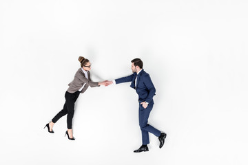 top view of business partners shaking hands isolated on white