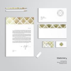 Vector corporate identity templates. Letterhead, envelope, business card, pencils, eraser. Modern golden foil pattern. Geometric frame in form of cut gems with a sun burst.