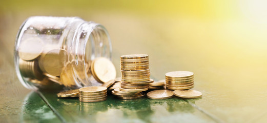 Money savings, save concept - web banner of gold coins with a jar glass