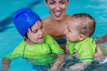 Cute little children in a swimming pool
