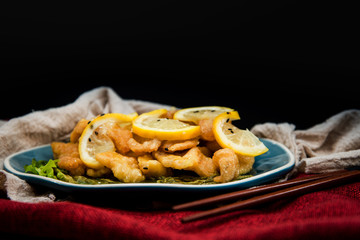 Chinese food fried fish and lemon slices