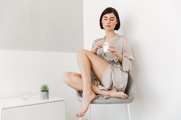 Portrait of a sensual young woman dressed in bathrobe