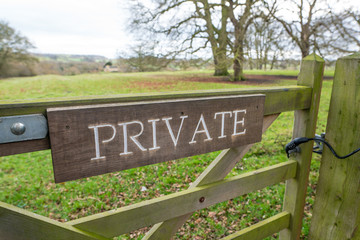 Locked field gate with large private sign in the English Countryside