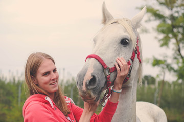 Female and beautiful horse. Friendship and love concepts.