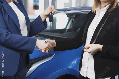 Handover of car keys in a dealership
