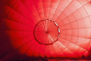 Inside a red hot air balloon in preparation