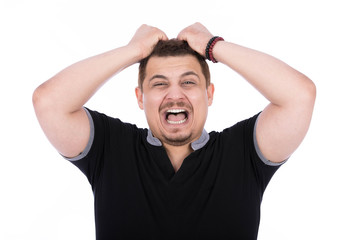 screaming man pulling his hair