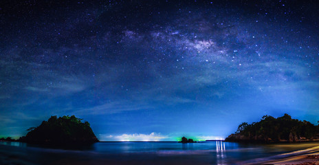 Landscape with Milky way galaxy. Night sky with stars and milky way over sea and mountain.