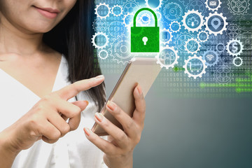 business woman hand holding smart phone with abstract cyber security background with gears and green lock pad icons ,concepts of technology, safety and privacy in the digital world