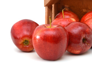 fresh  apples in a wooden crate on a white background