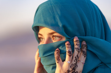 Arabian Moroccan woman with blue scarf in Morocco