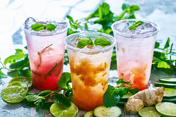 tasty infused water with ginger, lime, cucumber and fruits