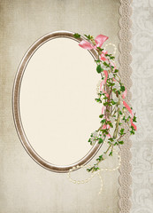 flowering branch with pink bow and ribbon on gold oval frame and lace border