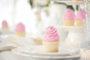 Birthday party celebration with pink cupcakes