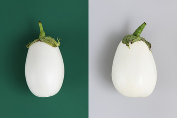 white eggplants isolated on green and gray background
