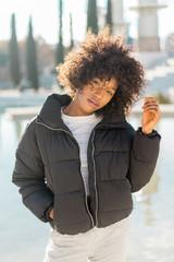 Stylish woman at city pond
