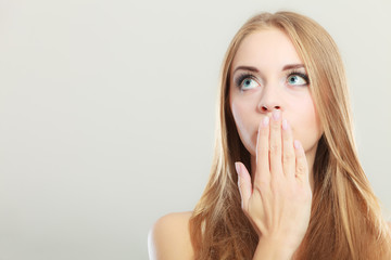 Amazed woman covering her mouth with hand