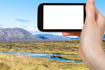 tourist photographs valley in Thingvellir
