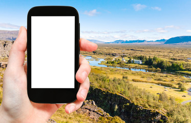 tourist photographs rift valley in Thingvellir