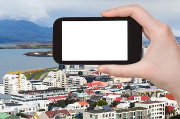 tourist photographs Midborg district in Reykjavik
