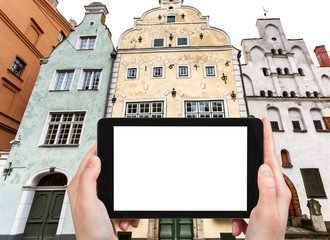 tourist photographs Three Brothers houses in Riga