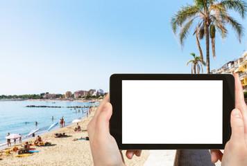 tourist photographs urban beach in Giardini-Naxos