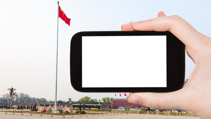 tourist photographs flag on Tiananmen Square