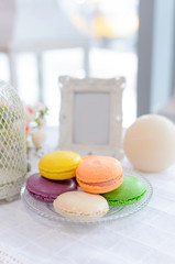 Tasty beautiful macaroons on a beautiful table in the style of Provence.