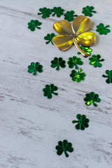 St Patrick's day with large gold four leaf clover and smaller green four leaf clovers