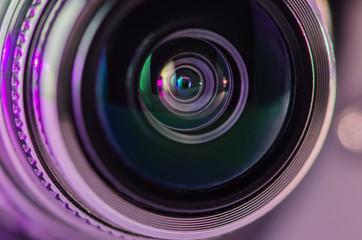The camera lens and light lilac color. Horizontal photo.