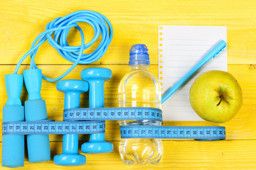Centimeter tied around sports tools and water bottle