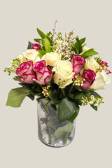 Flower arrangement of white and pink roses