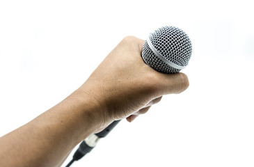 Hand is holding microphone on white background