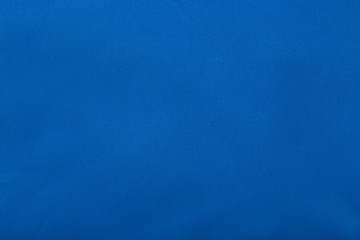 Blue material Close. Texture. Background. Bright. For your design. Coating.