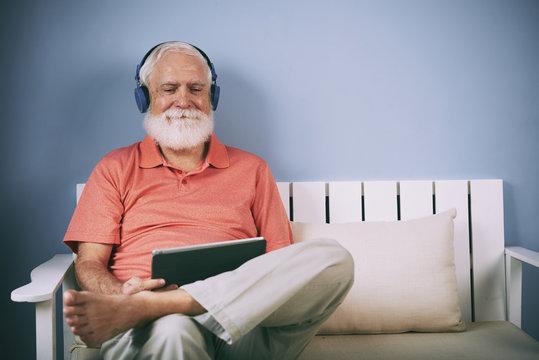 Senior watching movie on tablet
