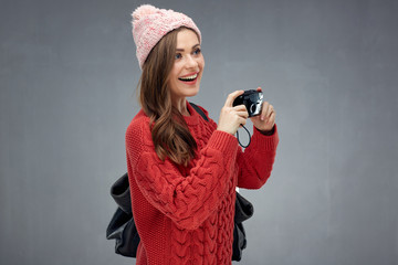 Happy girl tourist holding photo camera. woman traveler portrait