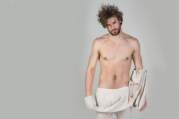 sexy man with uncombed hair with muscular body undress