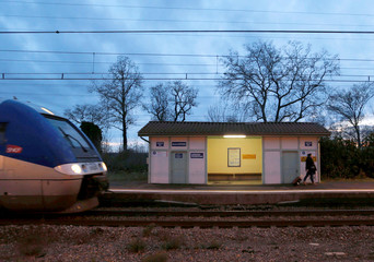 A train arrives at the French state-owned railway company SNCF station of Castelnau d'Estretefonds