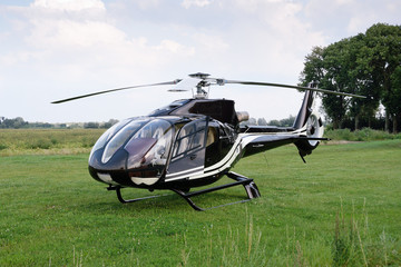Foto op Plexiglas Helicopter The Eurocopter EC 120B Colibri helicopter standing at the airport