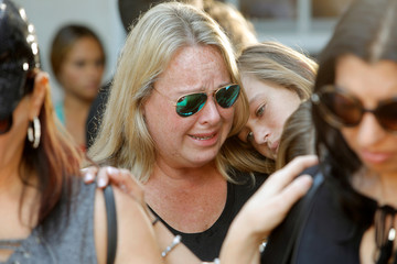 Mourners react during a community prayer vigil at Parkridge Church in Pompano Beach